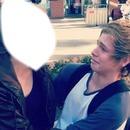 Luke Hemmings with a girl