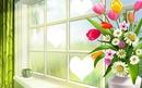 un bouquet de fleurs au bord d'une fenêtre 3 photo coeurs