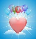 Luftballon fliegt mit Herz