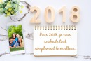 Felice anno nuovo 2018 con foto nel telefono e testo sul notebook