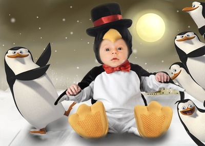 Baby gekleed in penguin Gezicht
