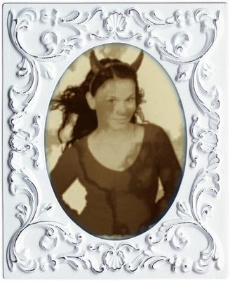 Vanha valokuvakehys laudaksi