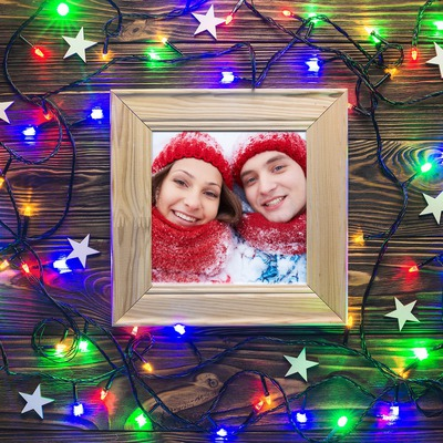 Frame with Christmas light string garland
