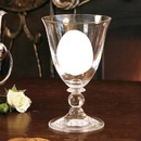 short stem wine glass with one flower