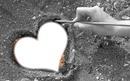 coeur dessiné sur le sable