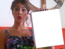 Tini holding a book