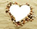 Coeur coquillage sur sable