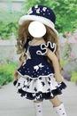 muñeca con sombrero azul