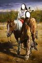 indios pareja a caballo