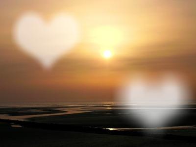 Deux coeurs battant au soleil couchant