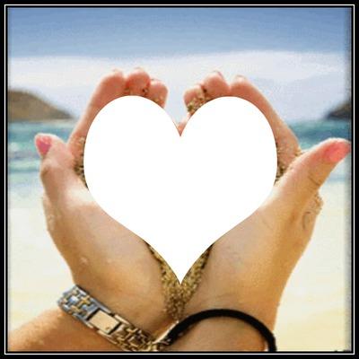 un coeur 1 photo dans la main