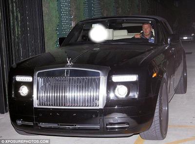 Photo dans une Porsche avec David Beckam